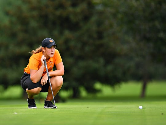 Central York's Cailey Roman eyeing up a putting during the York-Adams League Team Golf Championship at Briarwood East Golf Club in on Wednesday. Dawn J. Sagert photo