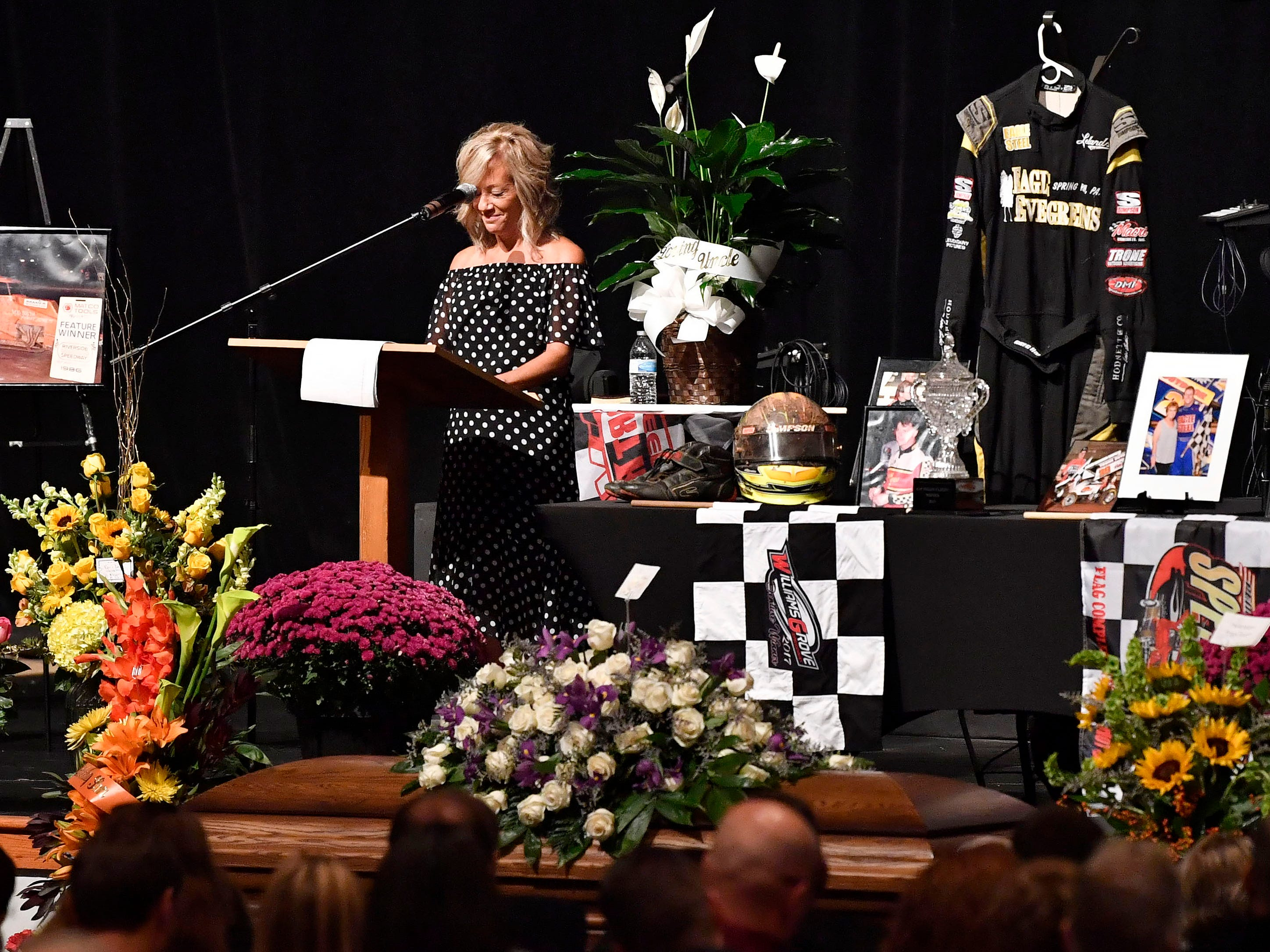 Sherry Hodnett smiles during a somber moment, following her tale of how she and her late husband, Greg Hodnett, fell in love. The sprint-car racer's funeral was held at Grace Fellowship Church on Wednesday. Hodnett, a local racing legend, died on Sept. 20 at BAPS Motor Speedway.