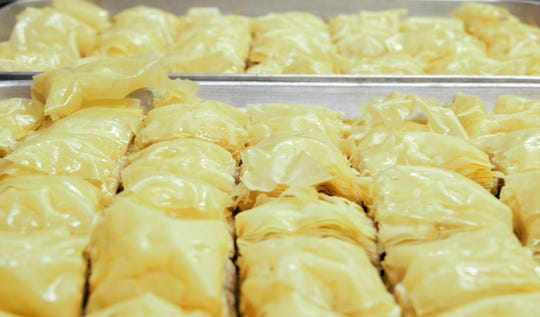 Hundreds of slices of baklava are prepared for the 65th annual Greek Food Festival at the Annunciation Greek Orthodox Church.