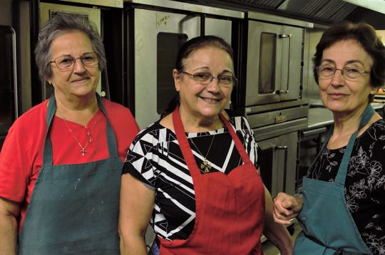 Pictured left to right: Agglia Tsoggas, Effie Vellious and Sotoriria Lammatos pose for a photo in the kitchen of the Annunciation Greek Orthodox Church.
