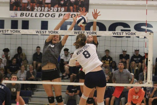 West York's Julia Rill hits into the front line of York Suburban Tuesday, Sept. 25, 2018.
