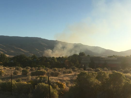 A fire burns in West Reno on September 25.
