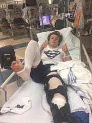 Damonte Ranch football Derrick Knoblock gives the thumbs up after being injured last season.