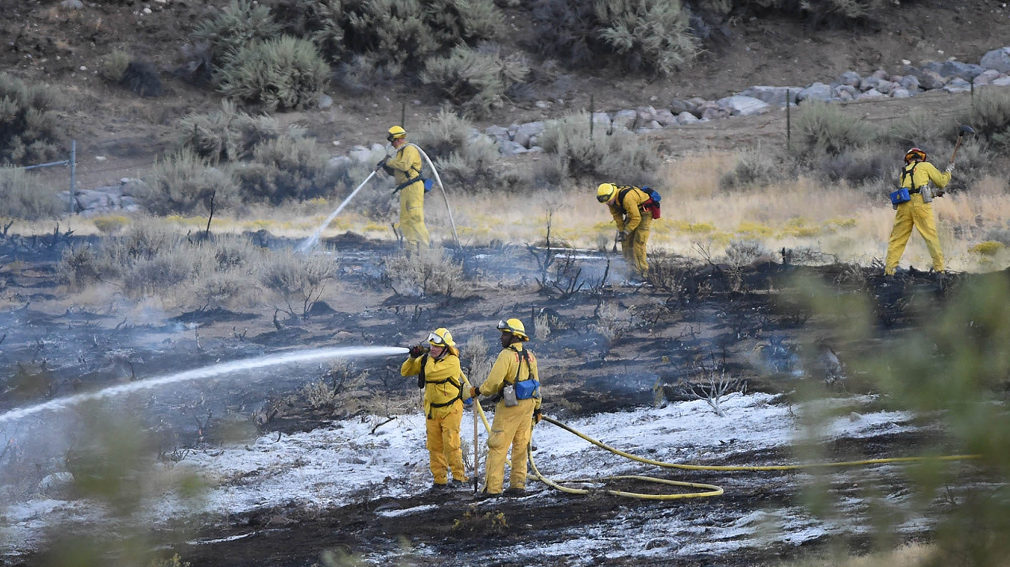 Firefighters work a brush fire that started on Tuesday afternoon off the I-80 west of the Rob Dive exit on Sept. 25, 2018.