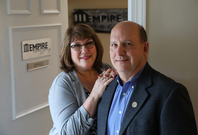 Cheryl and Jim White, co-founders of Empire Realty Group, at their Webster office. Jim served in the Navy before launching the business.