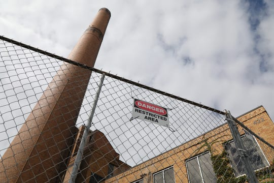 The smokestack at CityGate is cracked and its colorful signs have been removed.