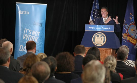 Gov. Andrew Cuomo talks about the success of Datto at a press conference for their new office location at the Metropolitan tower in downtown Rochester Wednesday, Sept. 26, 2018.