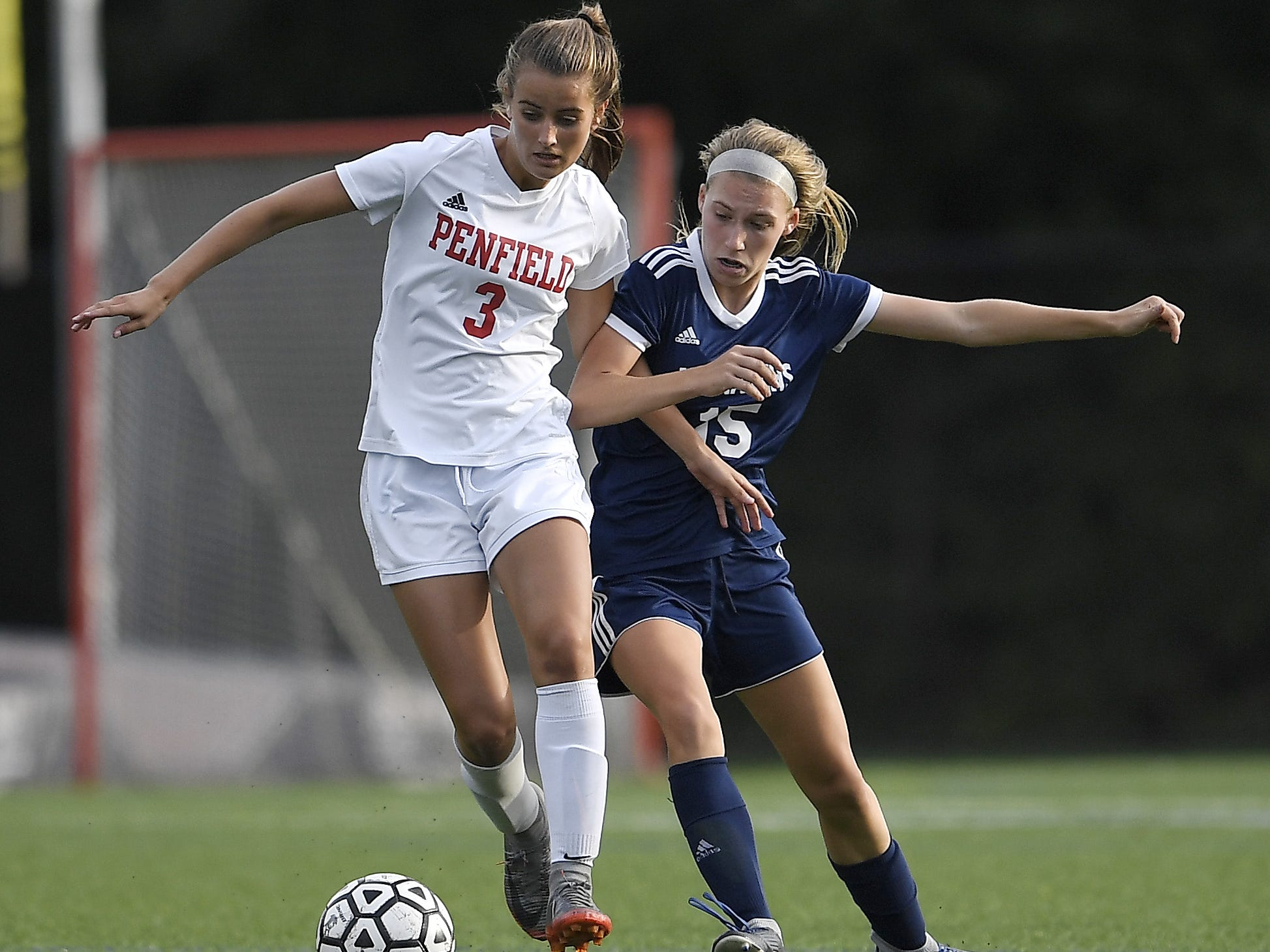 Penfield's Grace Murphy, left, shields the ball from Mercy's Shannon Trevor during a regular season game played at Our Lady of Mercy High School on Wednesday, Sept. 26, 2018. Mercy beat Penfield 1-0.