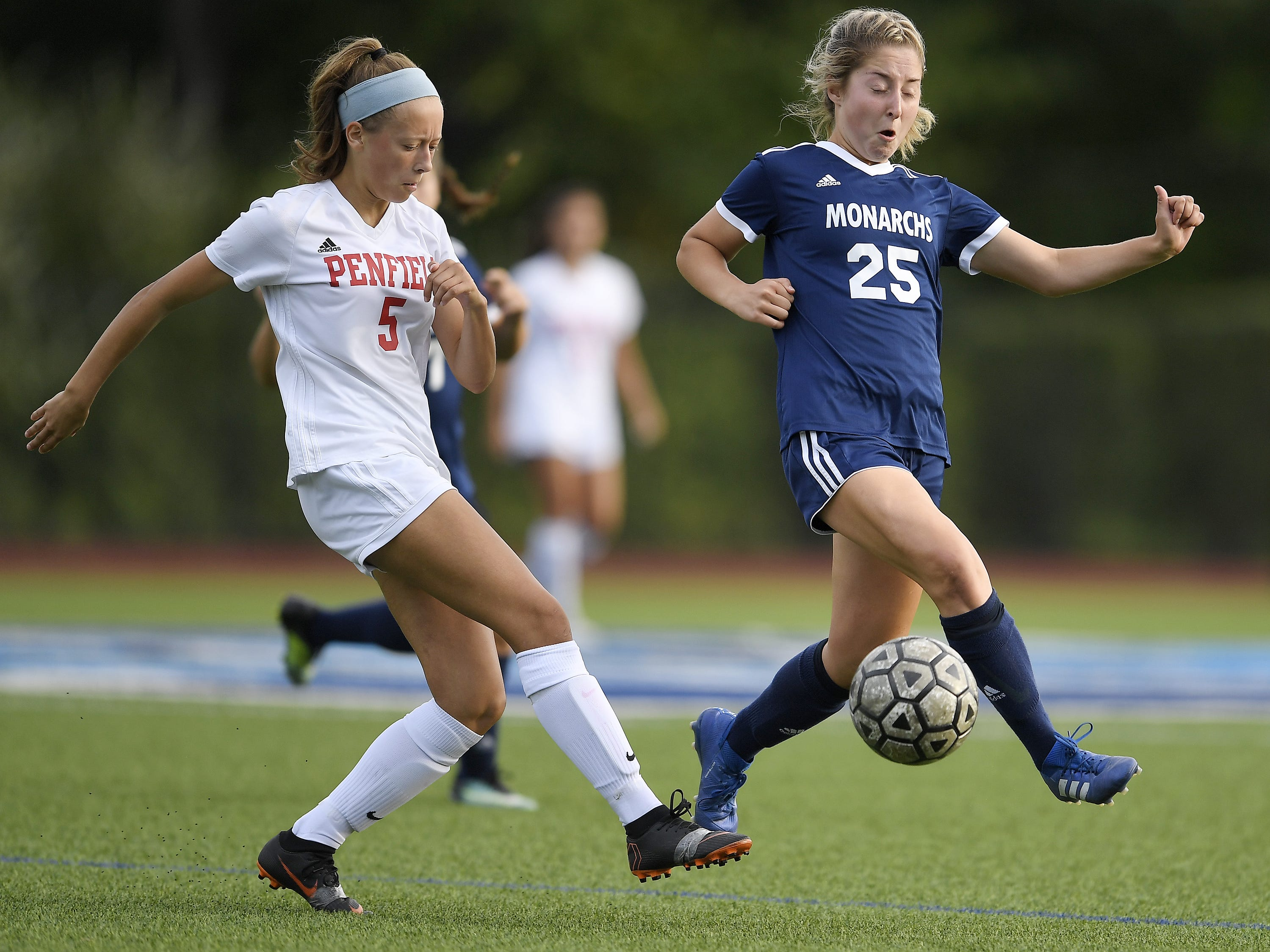 Penfield's Nicki Barlow, left, clears the ball past Mercy's Dori Rizzo during a regular season game played at Mercy on Wednesday.