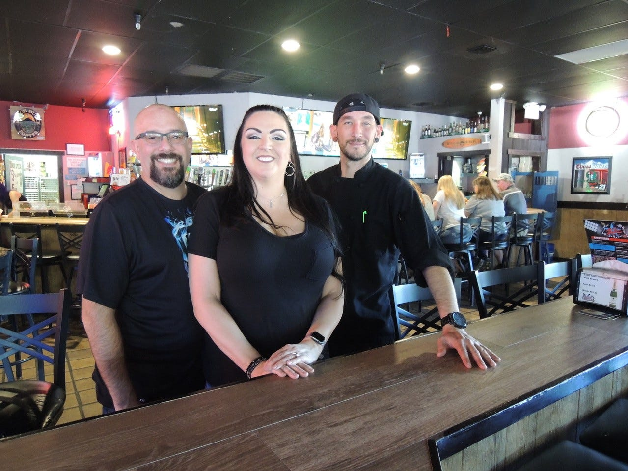 Owners Justin and Semone Bassett, left, and chef Chris Cordova at All Stars Sports Bar on Hartnell Avenue in east Redding.