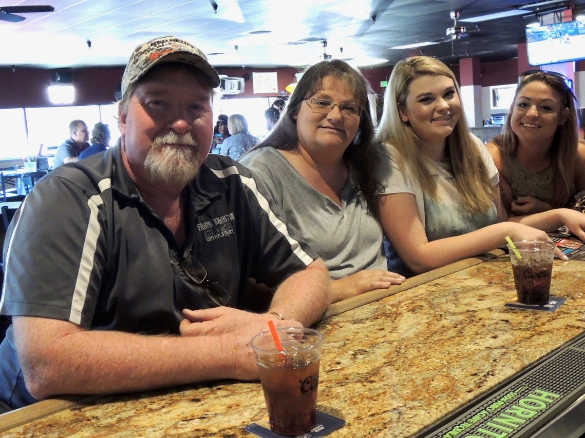 Waiting for their lunch order at All Stars Sports Bar in Redding--Frank and Vickie Johnston, left, Katie Johnston and Cassie Cardoza.