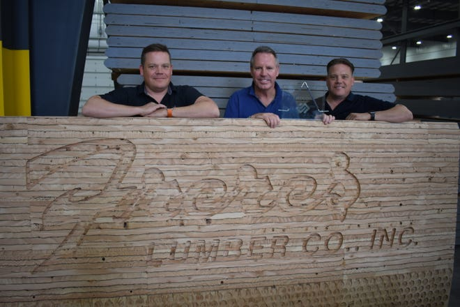 Tyler Freres, Rob Freres and Kyle Freres of Freres Lumber Co. pose with the SEDCOR Manufacturer of the Year award.