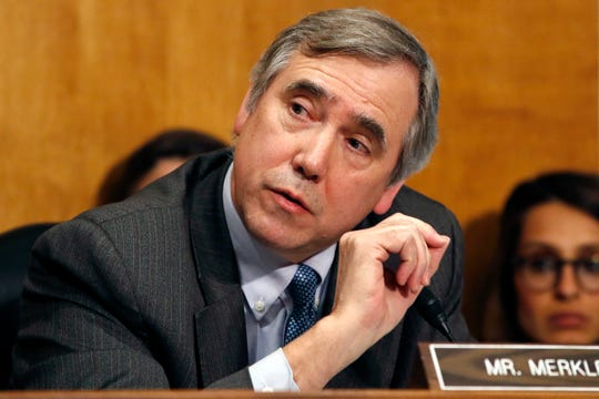 In this April 12, 2018 photo, Sen. Jeff Merkley, D-Ore., questions Secretary of State-designate Mike Pompeo during a Senate Foreign Relations Committee confirmation hearing on Capitol Hill in Washington. Charging that the Trump administration violated the separation of powers by withholding from the Senate 100,000 pages of documents on Supreme Court nominee Brett Kavanaugh, Merkley has filed suit, asking a federal court to order the administration to produce the papers and to delay confirmation hearings.