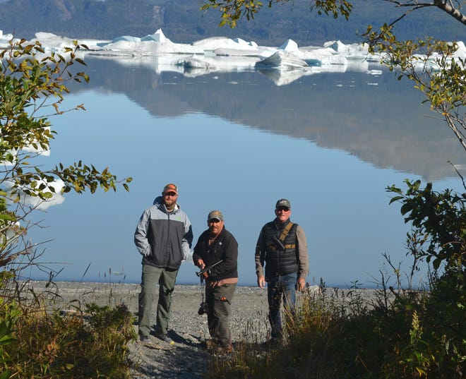 Left to right, Tom Wasson, Mike Flood and Rick Thoresen on the shore of Harlequin Lake with icebergs that calved from the Yakutat Glacier.