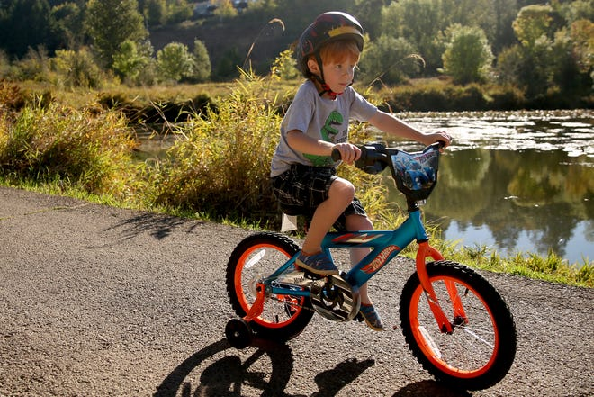 Ronin Andrus, 4, of Salem, rides his bike at Minto-Brown Island Park in Salem on Wednesday, Sep. 26, 2018.