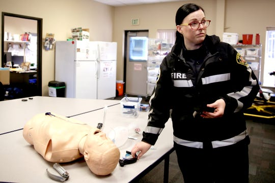 Sarah Merrick, a Salem Fire Department paramedic, demonstrates how to use an intubation device with a camera attached at the Training and Emergency Medical Services station in Salem on Wednesday, Sep. 26, 2018. The video camera helps medics care for patients more accurately and quickly.