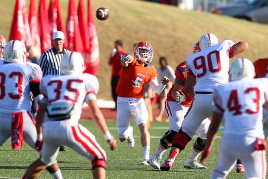 Central High School's Braden Hucks throws the ball downfield during a District 3-6A game against Odessa High in 2014 at San Angelo Stadium.