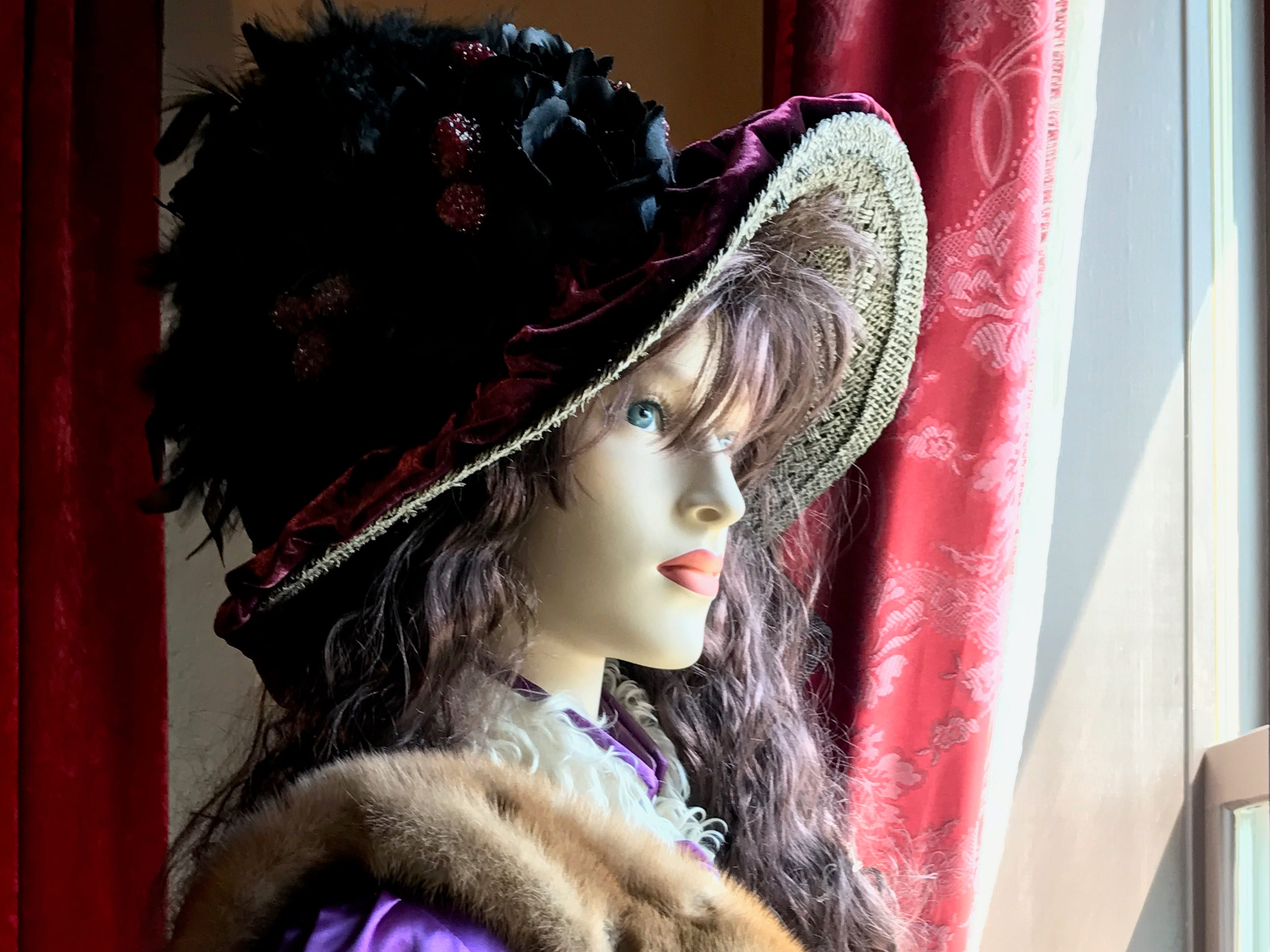 A replication of a bordello employee stares through a window of Miss Hattie's Bordello Museum.