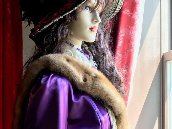 A replication of a bordello employee stares through a window of Miss Hattie's Bordello Museum.