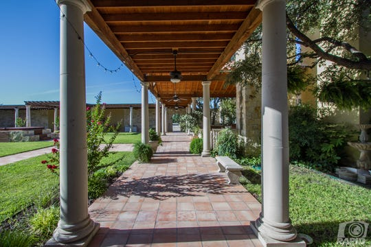 The covered walkways at 1543 Butler Drive show a well-maintained property. All 10 acres with the property are irrigated.