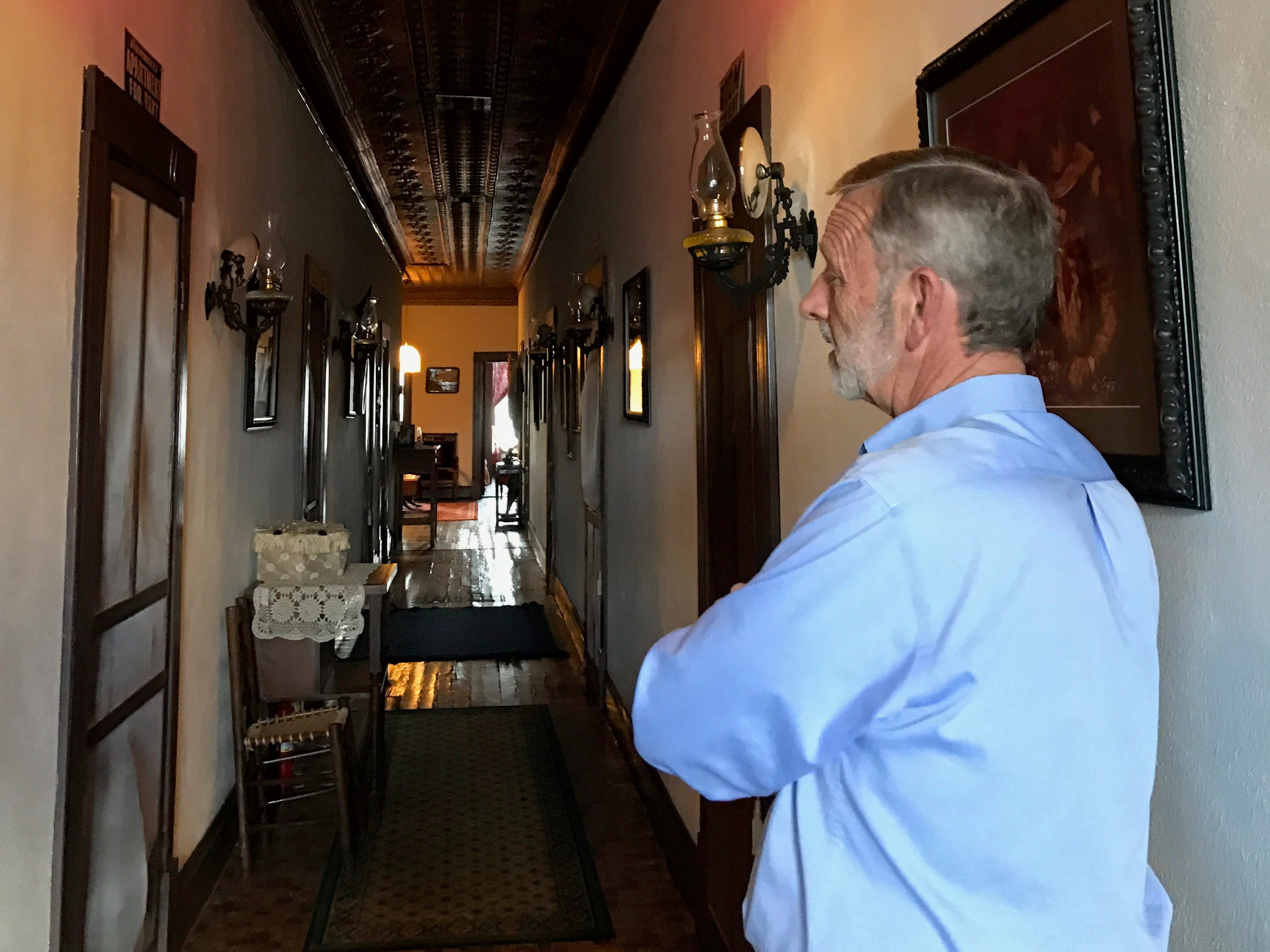 Mark Priest, building owner, walks through the museum Sept. 18, 2018, at Miss Hattie's Bordello Museum. Priest had many experiences in the building over the last 21 years.