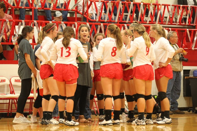 Miles High School head volleyball coach Kaitlyn Braswell goes over things with the Lady Bulldogs during a District 7-2A match against Water Valley at the Miles gym on Tuesday, Sept. 25, 2018.