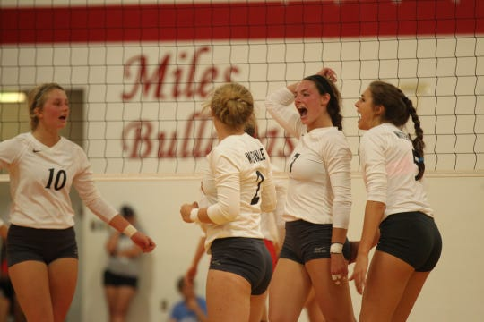 The Water Valley High School Lady Wildcats celebrate during a District 7-2A volleyball win against Miles at the Miles gym on Tuesday, Sept. 25, 2018.