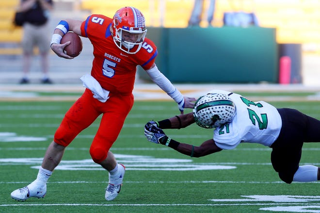 Central High School's Braden Hucks avoids a tackle from Southlake Carroll's Tariq Gordon during a Class 6A Division II regional semifinal playoff game in 2014 at McLane Stadium in Waco.