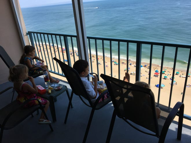 """The Jancosko children look out on the oceanfront view of their new Ocean City home featured on HGTV's """"Beachfront Bargain Hunt."""" Courtesy of Angela Jancosko."""