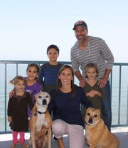 "The Jancosko family pose on the balcony of their new Ocean City home featured on HGTV's ""Beachfront Bargain Hunt.""  (Pictured from left to right) Adelaide, Isabella, Jackson, Jason, Scarlett and Angela Jancosko (center). Courtesy of Angela Jancosko."