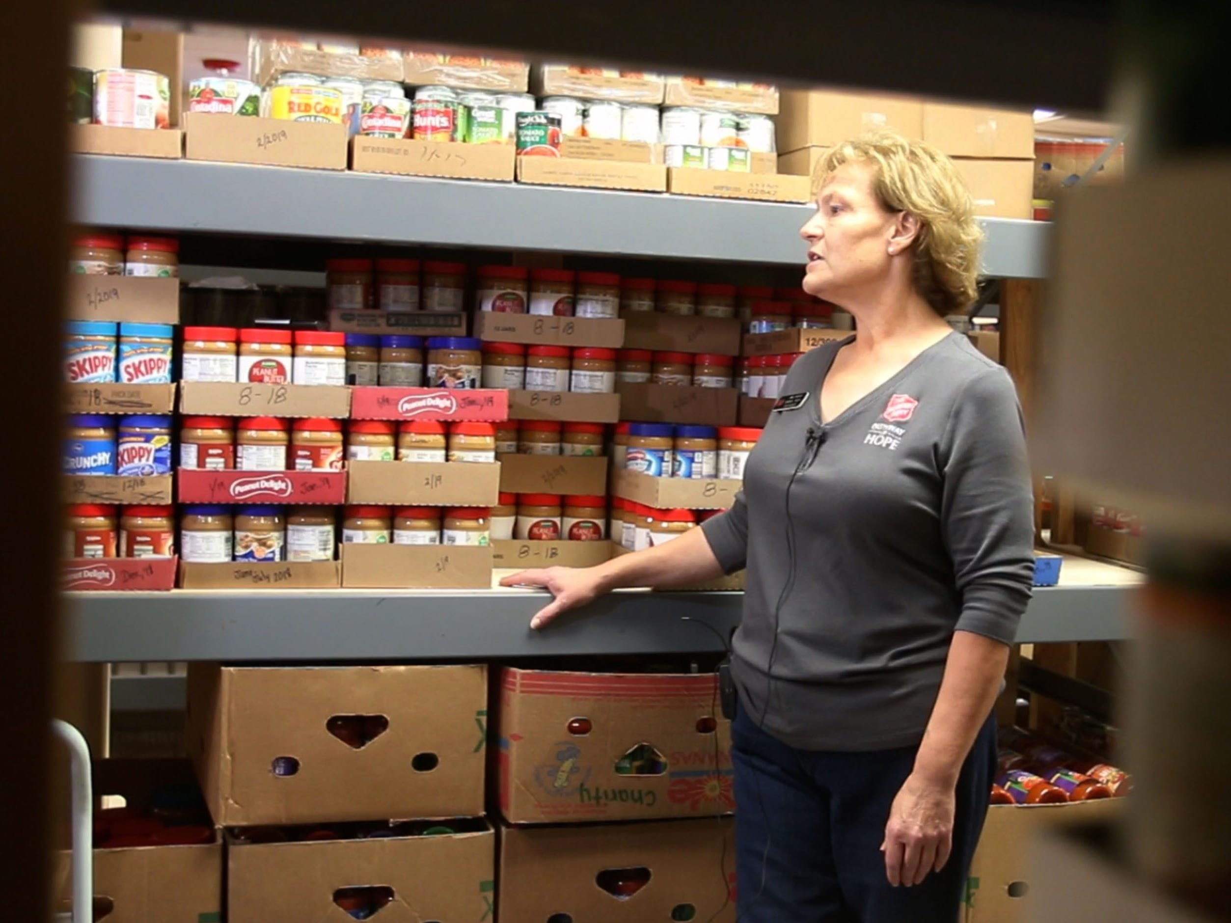 Salvation Army General Needs Case Worker Jane Marotz, speaks to the media while standing near the shelves in the food pantry at the facility Sept. 20 in Sheboygan, Wis.