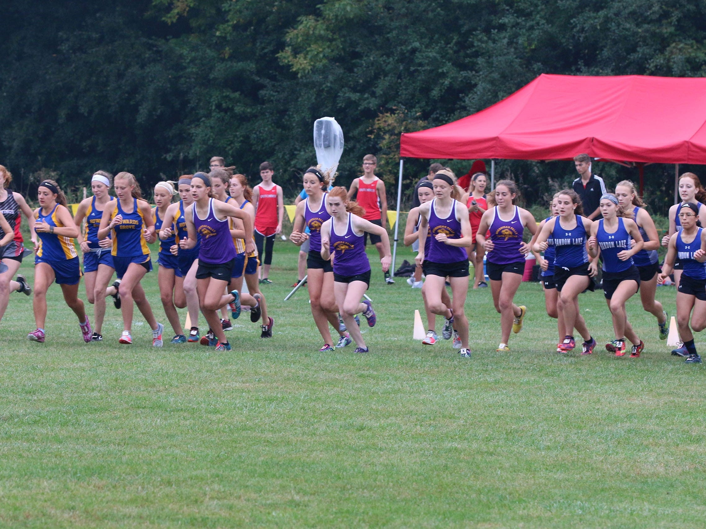 The start of the varsity girls portion of the Sheboygan County Cross Country Invitational, Tuesday, September 25, 2018, in Sheboygan, Wis.