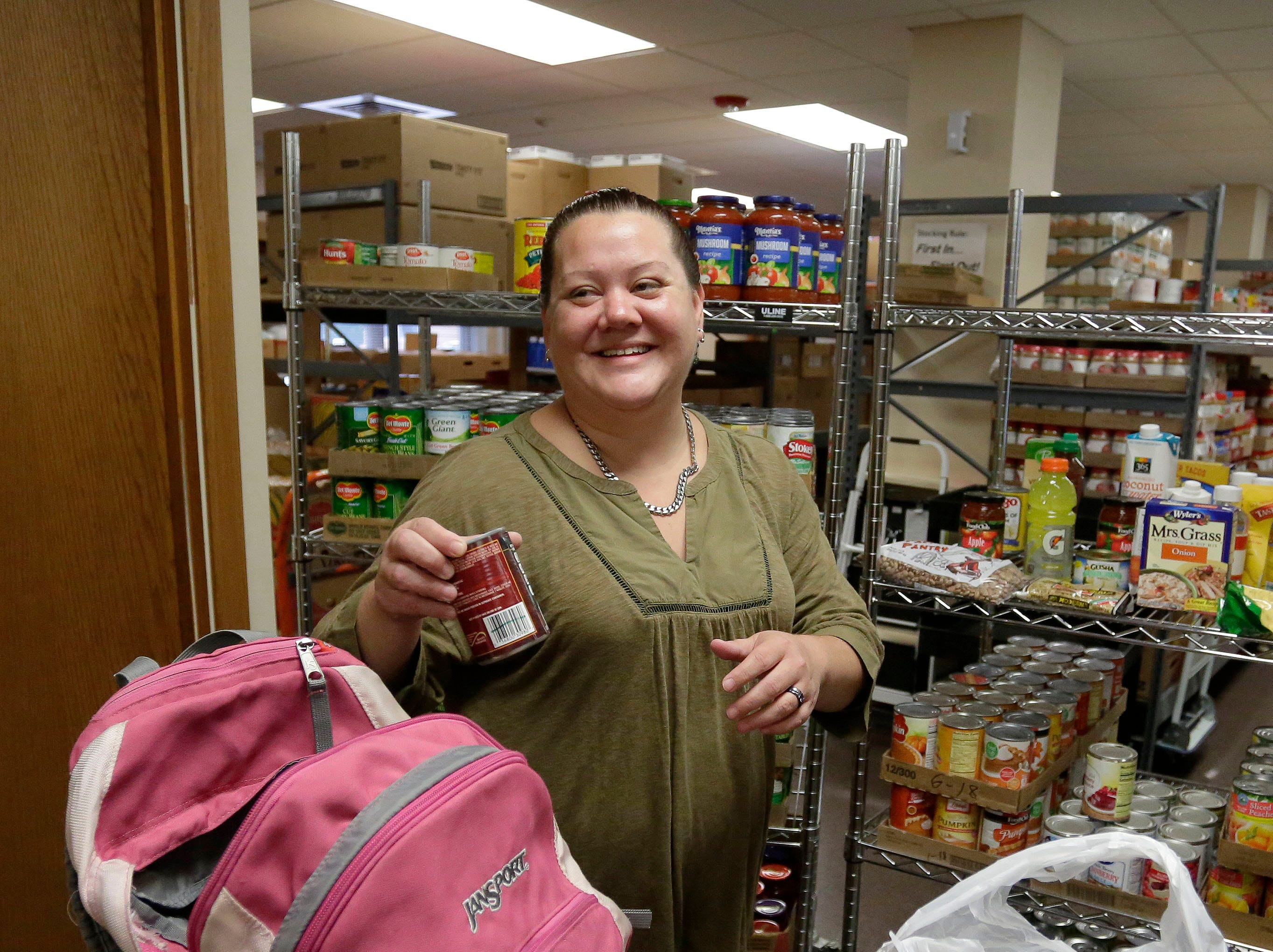 Sheboygan Salvation Army food pantry recipient Rose Hauch, of Sheboygan, Wis., smiles while on her monthly visit to the pantry, Thursday, September 20, 2018, in Sheboygan, Wis.