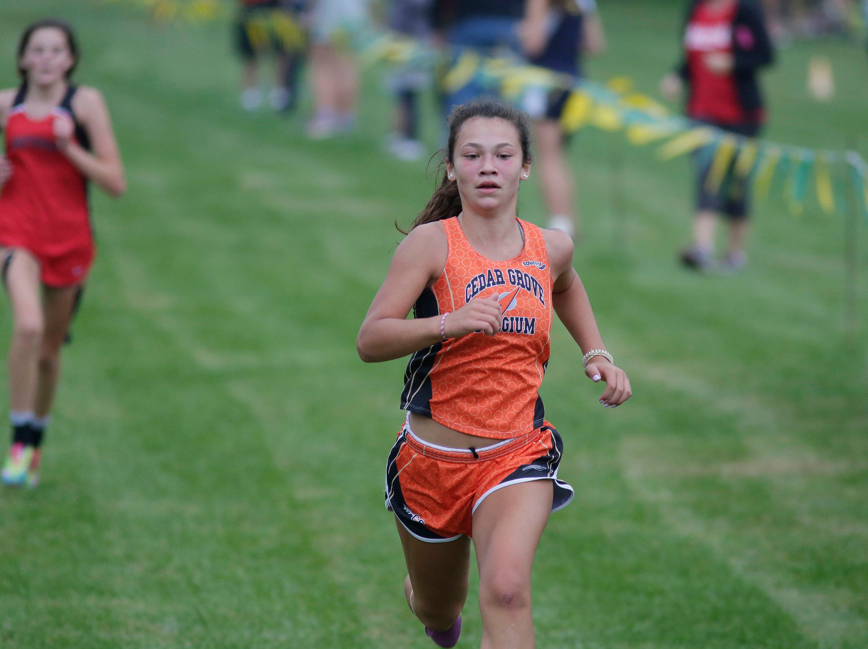A Cedar Grove-Belgium runner at the Sheboygan County Cross Country Invitational, Tuesday, September 25, 2018, in Sheboygan, Wis.