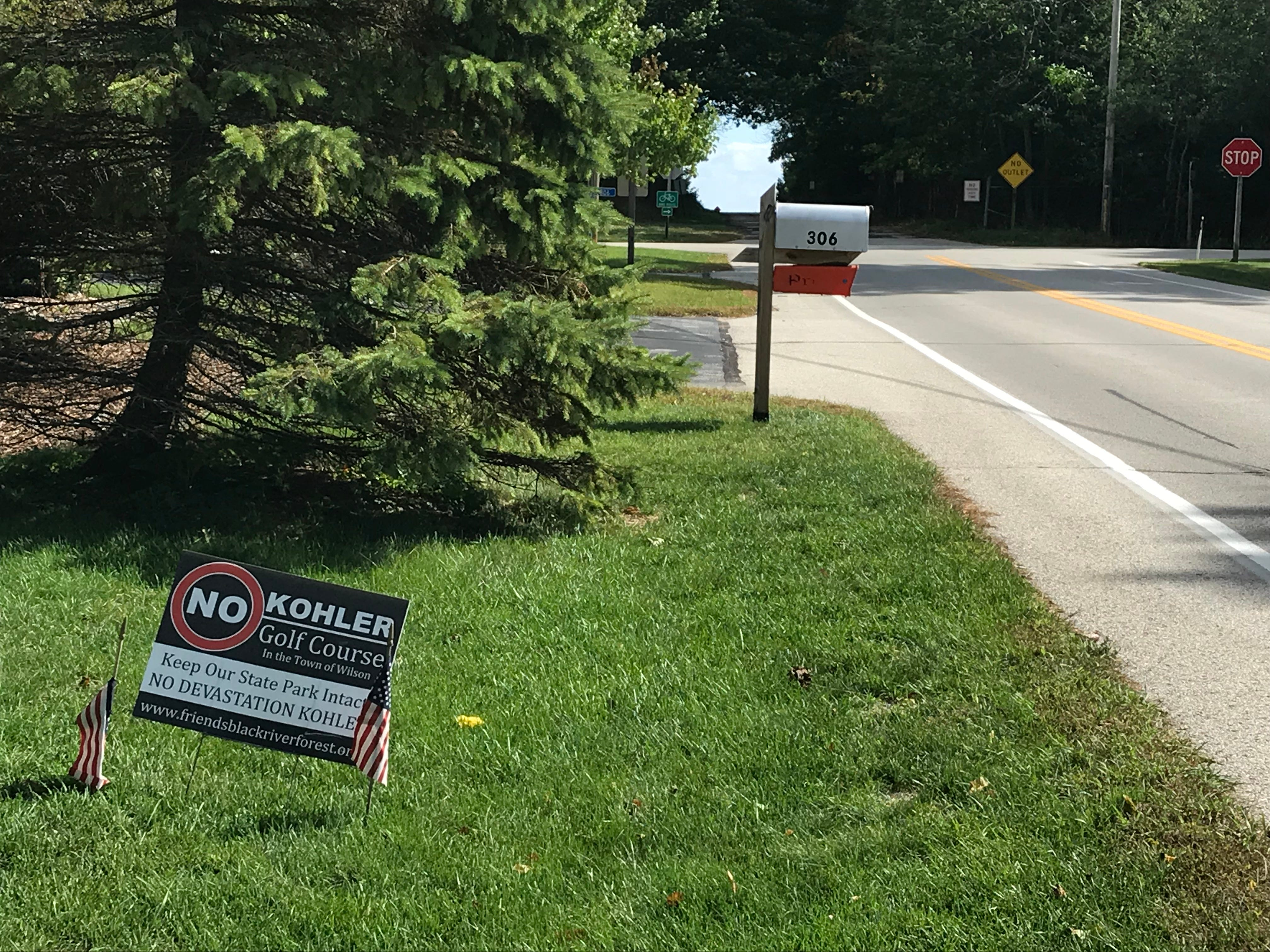 An anti golf course sign in a front yard near Black River as seen, Wednesday September 26, 2018, in Sheboygan, Wis.
