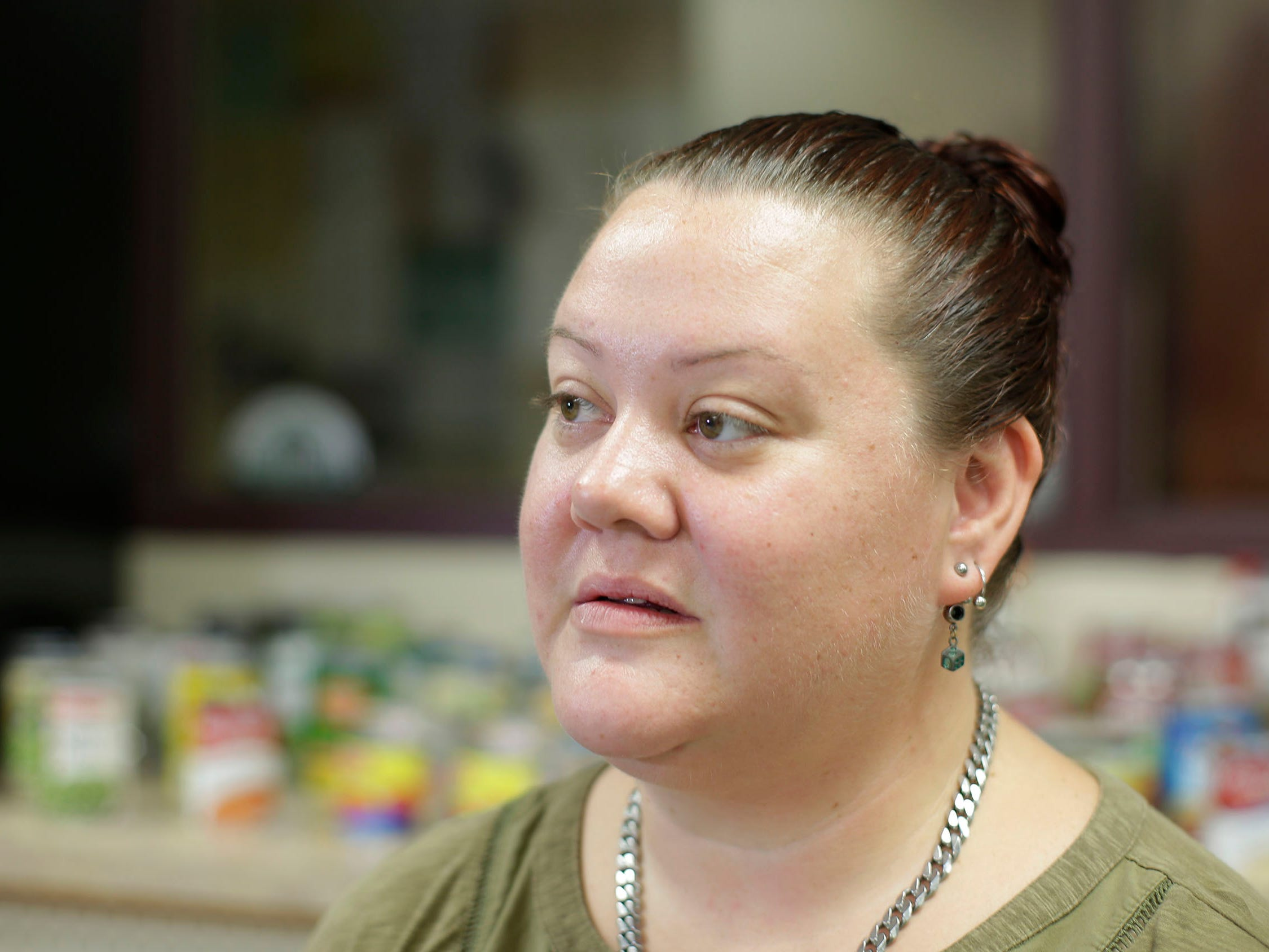 Sheboygan Salvation Army food pantry recipient Rose Hauch, of Sheboygan, Wis., speaks to the media about how the food pantry makes a difference in her life, Thursday, September 20, 2018, in Sheboygan, Wis.  Hauch is on a fixed income and the pantry helps her with her food needs.