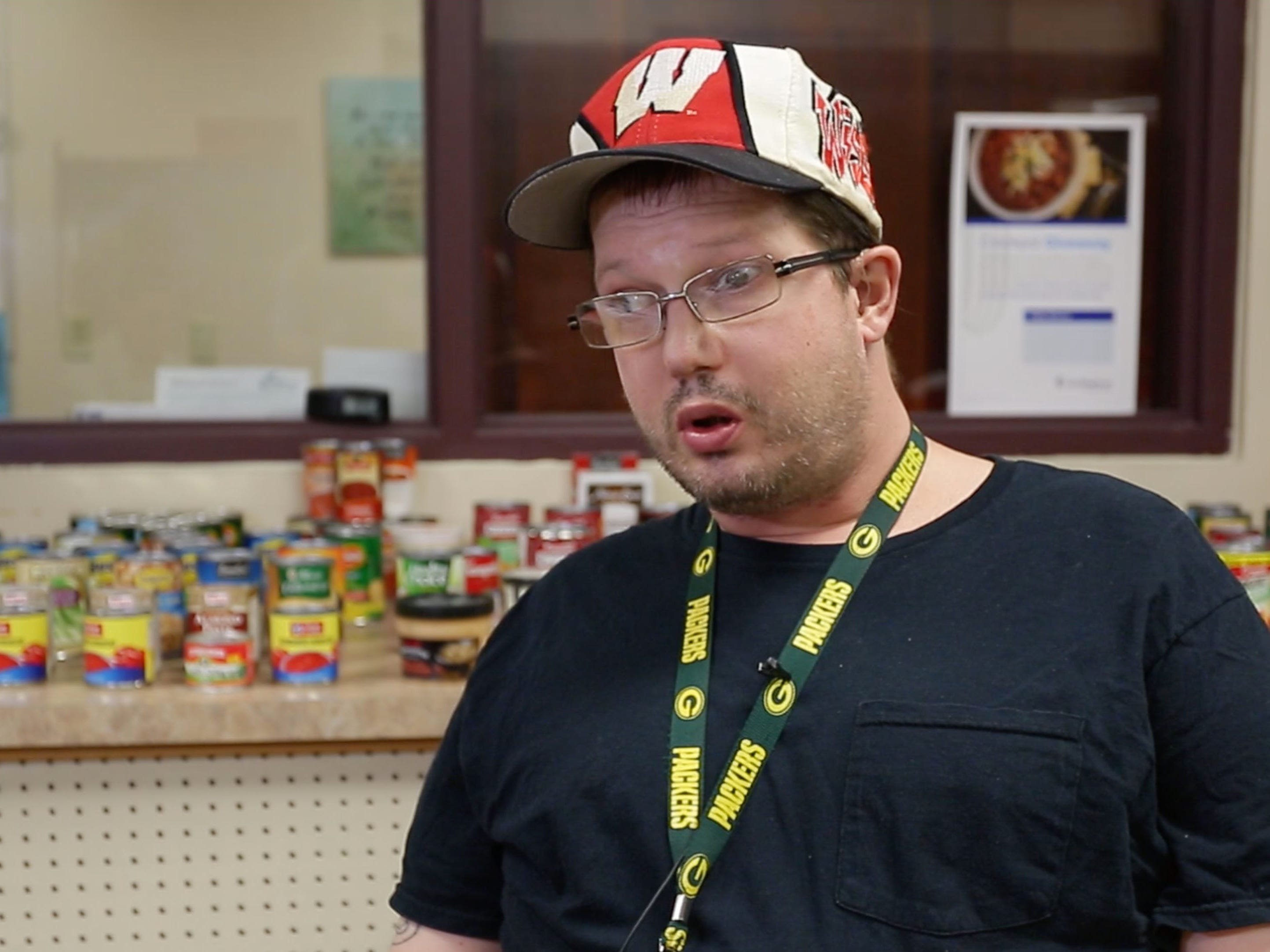Sheboygan Salvation Army food pantry recipient Garrick Dortman, of Sheboygan, Wis., speaks to the media about how the food pantry makes a difference in his life, Thursday, September 20, 2018, in Sheboygan, Wis.  Dortman, who is on a fixed income says the pantry helps him with his food needs each month.