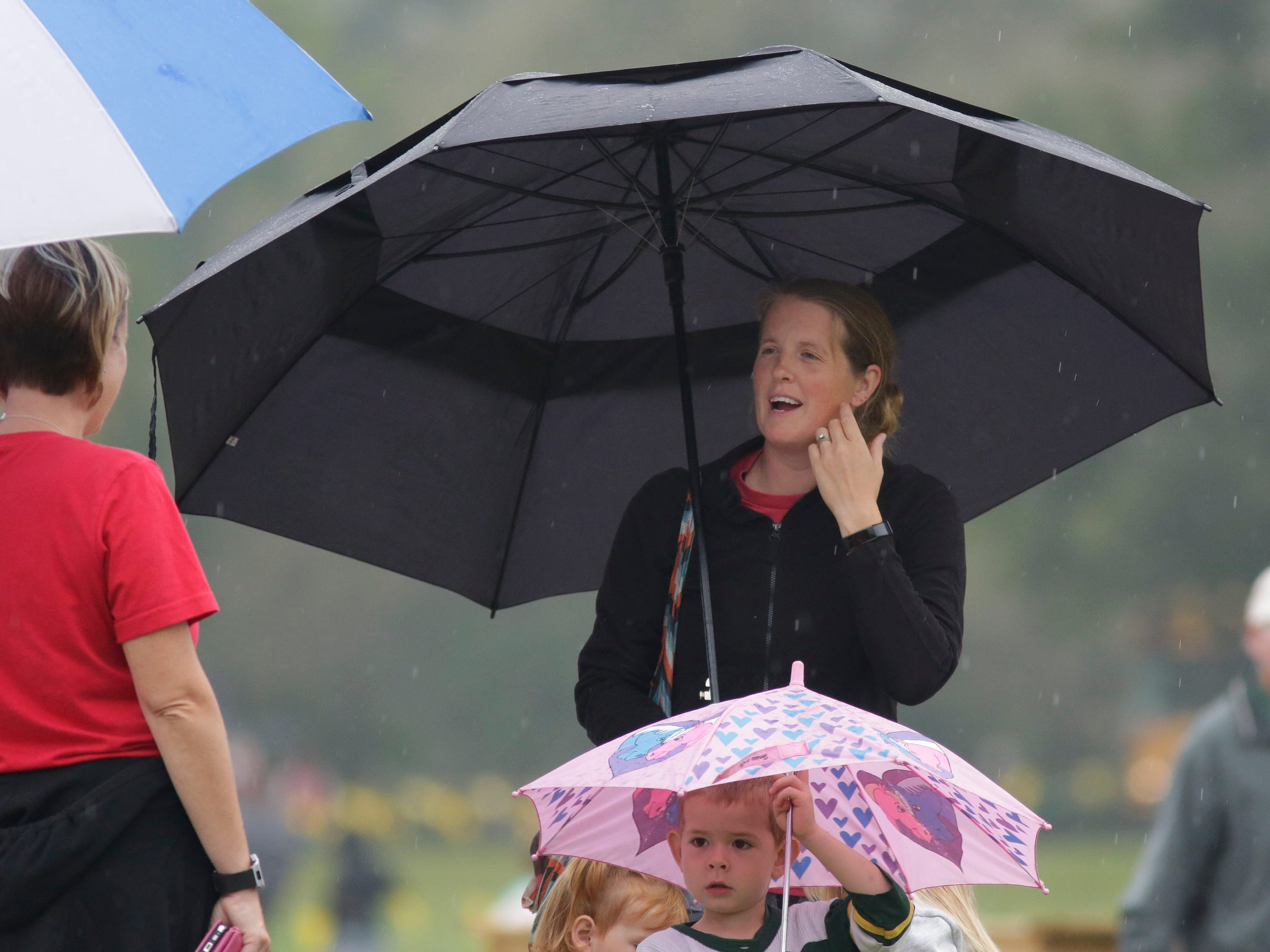 Umbrellas were used in the light rain that fell during the Sheboygan County Cross Country Invitational, Tuesday, September 25, 2018, in Sheboygan, Wis.