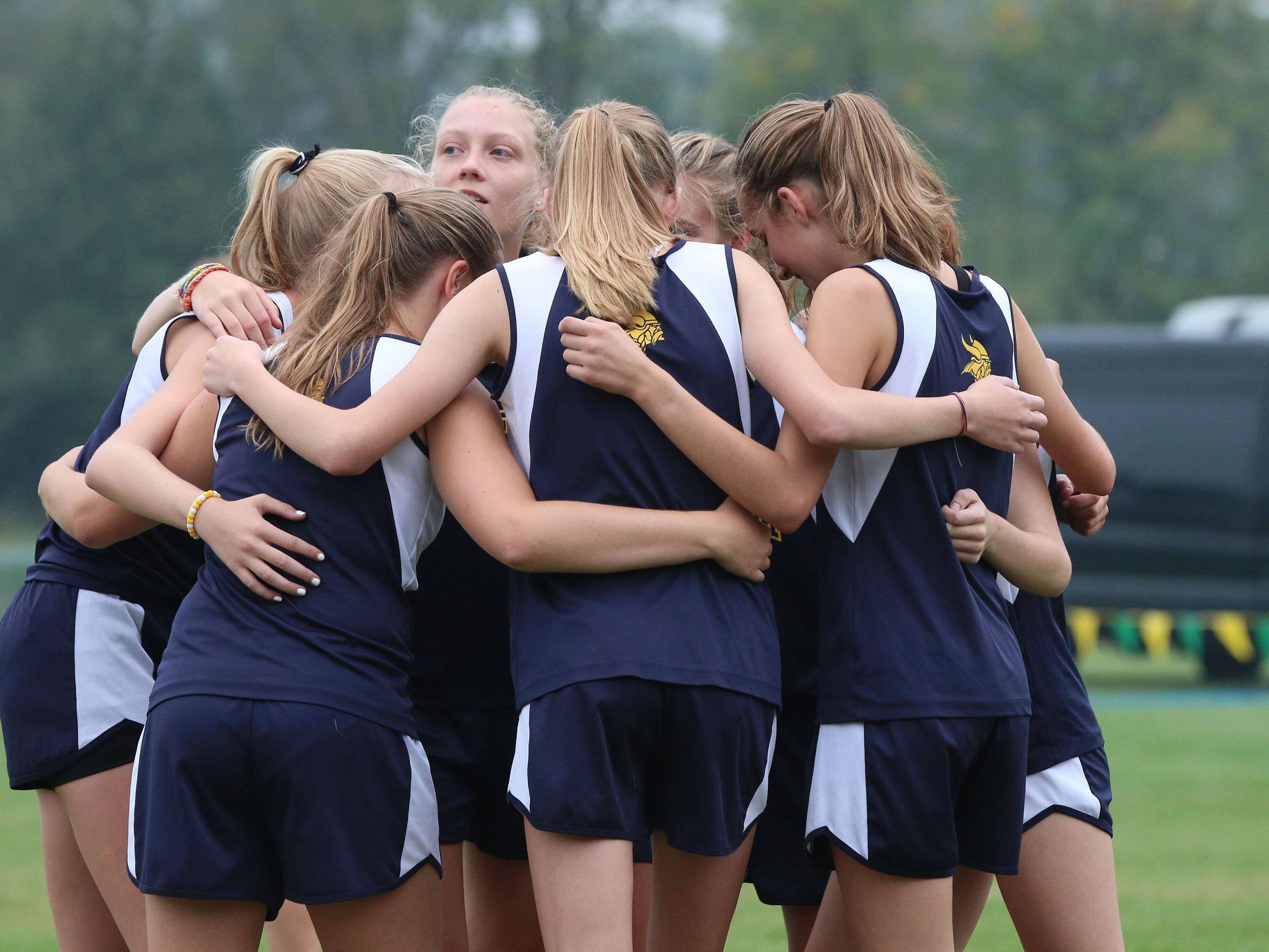 Sheboygan North girls huddle before the Sheboygan County Cross Country Invitational, Tuesday, September 25, 2018, in Sheboygan, Wis.