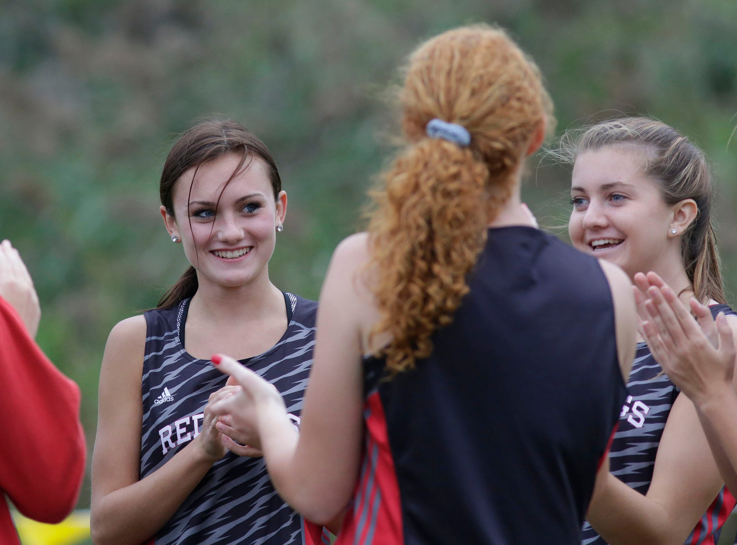 Sheboygan South girls are all smiles before embarking on their run at the Sheboygan County Cross Country Invitational at Sheboygan Lutheran, Tuesday, September 25, 2018, in Sheboygan, Wis.