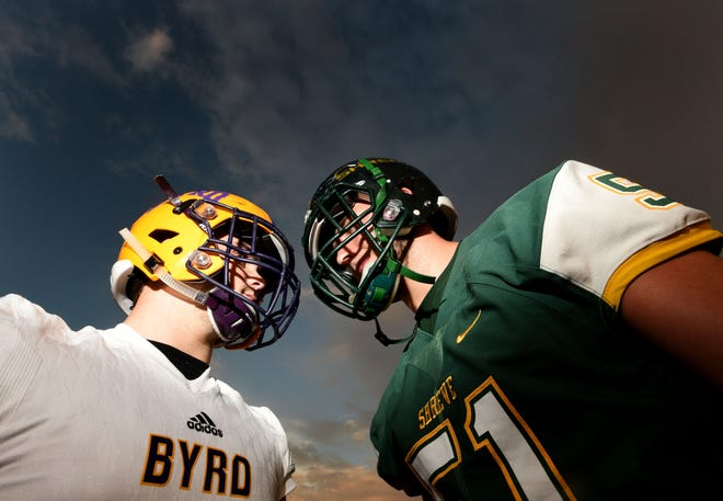 Byrd's Nick Erwin, left, will be recognized Thursday by the S.M. McNaughton Chapter of the National Football Foundation and College Hall of Fame