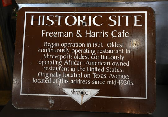 Orlandeaux's Cafe shows its roots by hanging a Freeman and Harris Cafe sign in the dinning room.
