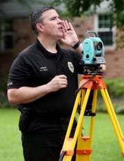 Bossier City Police Department Sgt. S.J. Wells works on the evidence on the 500 block of Parklane Drive Wednesday morning in the GreenAcres Place subdivision.
