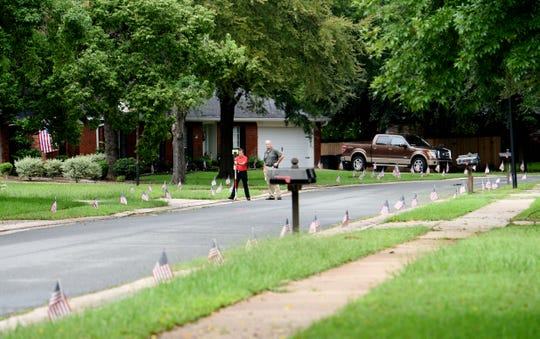Bossier City Police Department works on the evidence on the 500 block of Parklane Drive Wednesday morning in the GreenAcres Place subdivision.