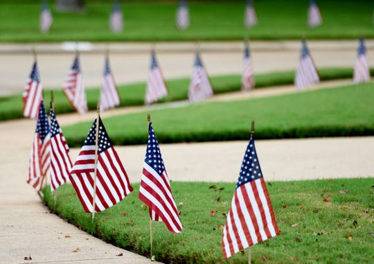 American flags line the streets in the GreenAcres Place subdivision in memorial to Tech. Sgt. Joshua L. Kidd.