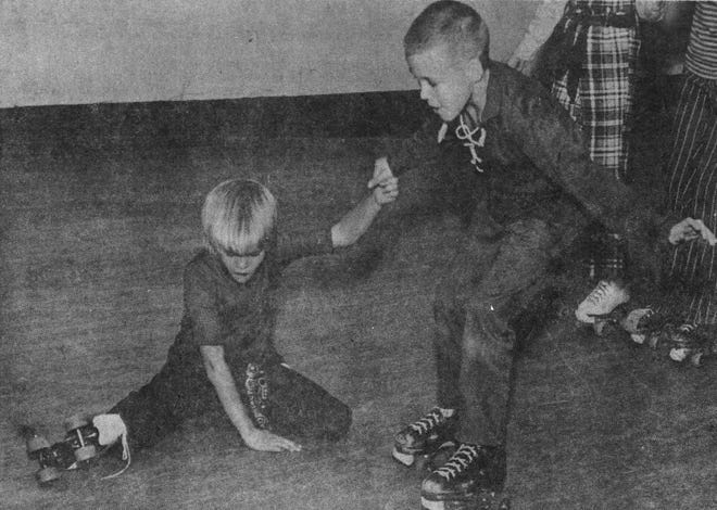 Valley Elementary School (Valley Springs) students Debbie Larson and Troy Smith enjoy a 1969 skating party at West Soo Roller Rink.