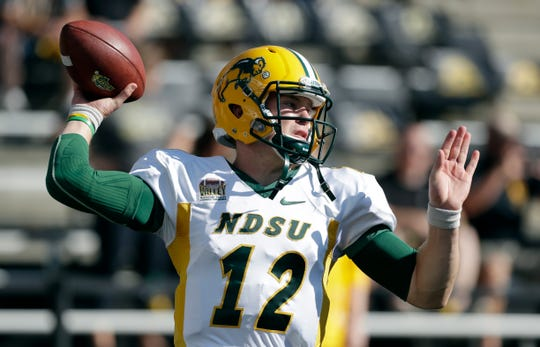 North Dakota State quarterback Easton Stick warms up before an NCAA college football game against Iowa, Saturday, Sept. 17, 2016, in Iowa City, Iowa.