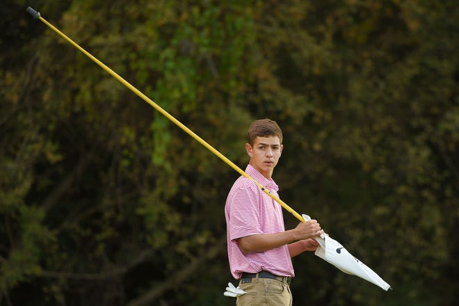 Lincoln's Ryan Neff golfs in the Metro Athletic Conference boys golf championships Wednesday, Sept. 26, at the Brandon Municipal Golf Course in Brandon.