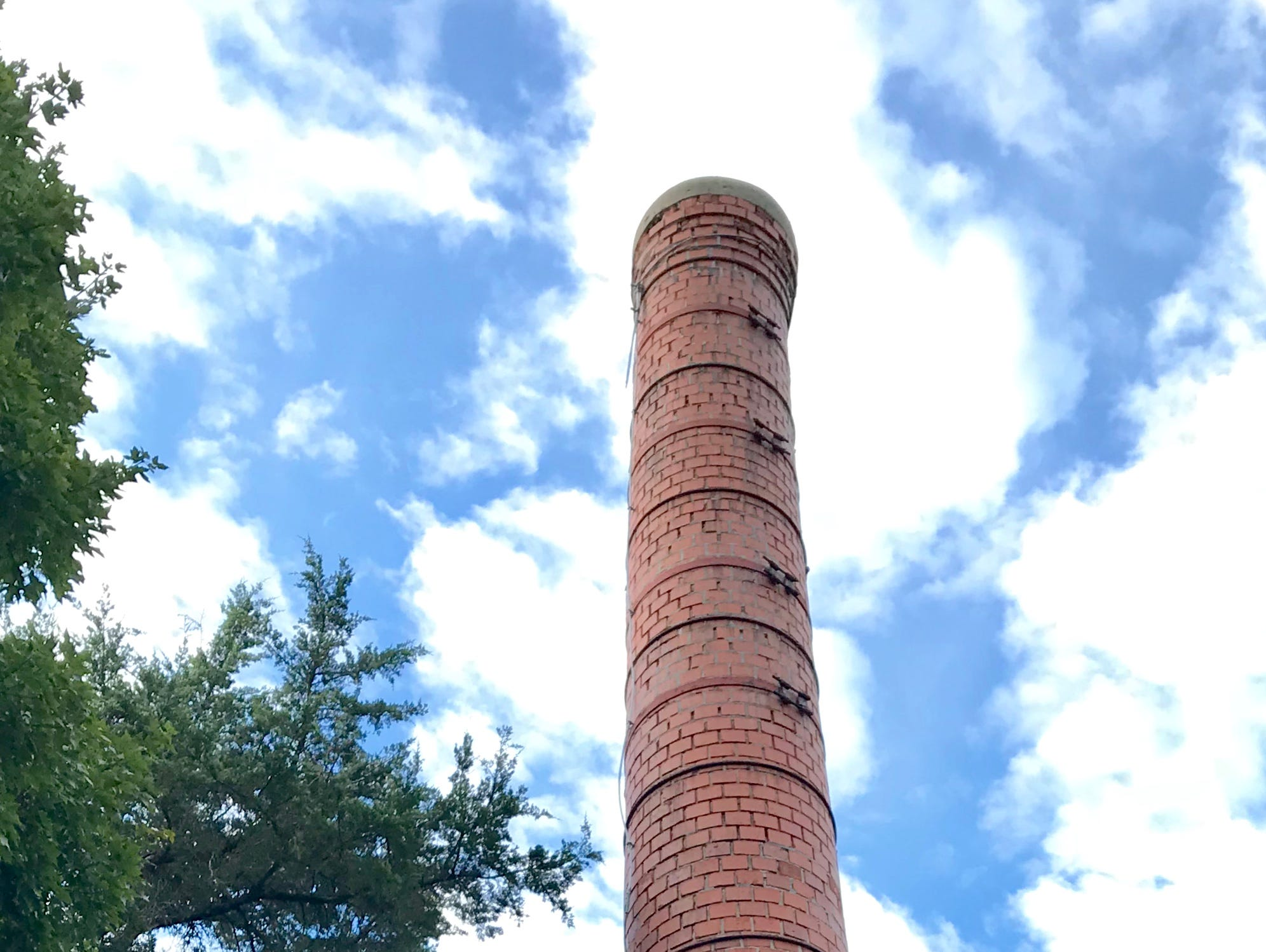 If this chimney looks crooked, it's because it is. And the owners of the Elfindale Mansion know it. It's been crooked for at least 30 years.