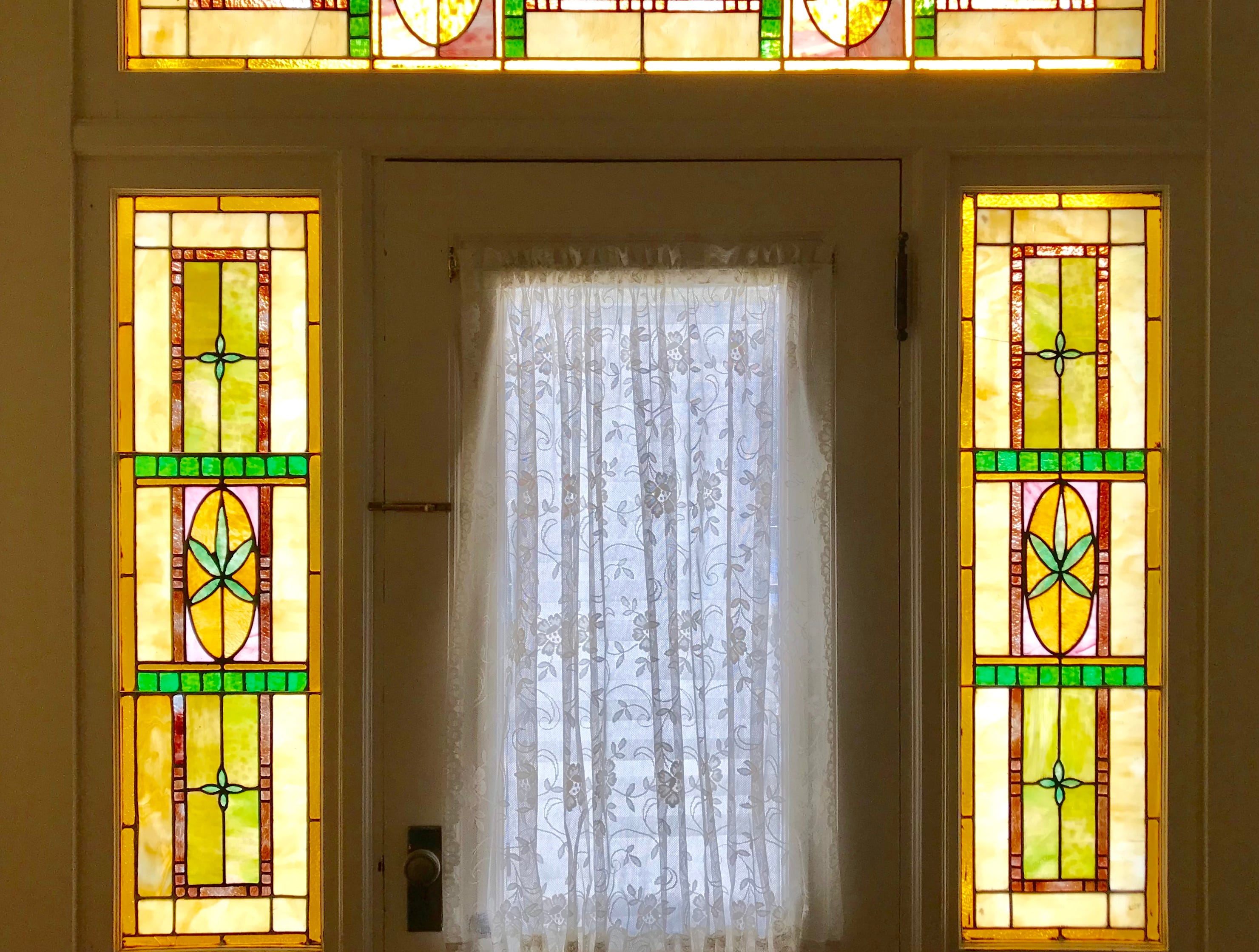 The Elfindale Mansion is a bed and breakfast with 13 bedrooms. This second-story room has beautiful stained glass and a walk-out deck.